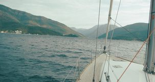 Travel around the Europe. Montenegro and Albania. White boat rides across Bay of Kotor in a sunny day.  stock footage