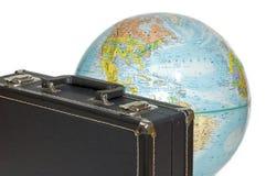 Travel around the globe. Suitcase and globe; travel around the world Stock Photography