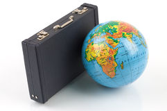 Travel around the world. Little globe and a black siutcase against the white background stock image