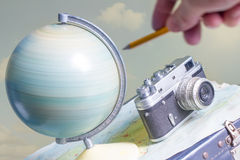 Travel around the world with a camera and globe Royalty Free Stock Photos