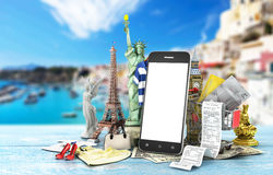 Travel around the world concept. The most popular attractions with shopping trolley near phone with empty screen. World shopping. 3d illustration Stock Photography