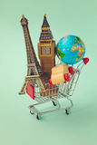 Travel around the world concept. Shopping cart with souvenir from around the world. Retro filter effect Royalty Free Stock Photography