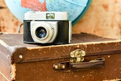 Travel concept. Travel around the world with   retro camera, globe  and suitcase concept Stock Photos