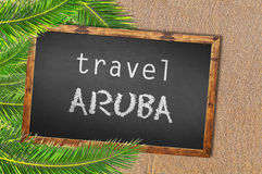 Travel Aruba palm trees and blackboard on sandy beach. Close Royalty Free Stock Photos
