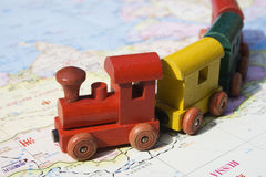 Travel in Asia and Russia. A map of Asia and a toy train.  This is the dream of international travel and adventure.  Also refers to the transsiberian train Stock Photo