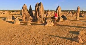 Travel in Australia. Western Australia travel discovery concept. Traveler woman walks through Pinnacles Desert, Nambung National Park, Cervantes. Female walking stock video footage