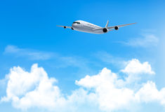 Travel background with an airplane and white clouds. Royalty Free Stock Image