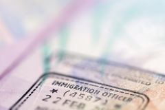 Travel Background with Passport Immigration Visa Stamp stock photography