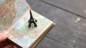 Travel background, trip to France idea. Travel and tourism background - eiffel tower and map stock video