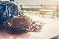 Travel backpack with hat and sunglasses Stock Image