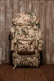 Travel backpack khaki color on a wooden background Stock Photos