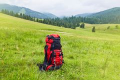Travel backpack on the mountain landscape view background. stock image