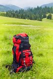 Travel backpack on the mountain landscape view background. royalty free stock photography