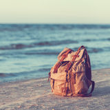 Travel Backpack on Sea Beach. Stock Images