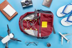 Travel Backpacker objects and accessories on blue. Background Stock Photography