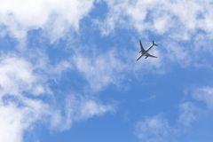 Travel backround with a plane in the sky. Travel background of a commercial plane flies in the sky toward blue sky Royalty Free Stock Photo