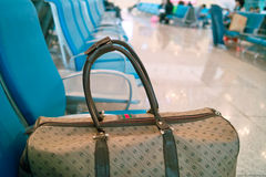 Travel bag. A travel bag on the chair of the railway station stock photo
