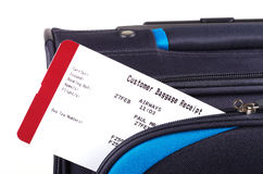 Travel bag and airline baggage receipt Royalty Free Stock Images