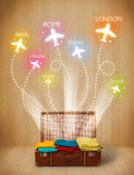 Travel bag with clothes and colorful planes flying out Royalty Free Stock Photography