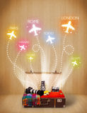 Travel bag with clothes and colorful planes flying out Stock Photos
