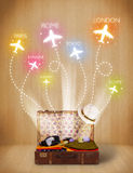 Travel bag with clothes and colorful planes flying out Royalty Free Stock Photos