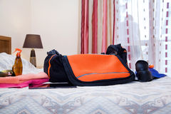 Travel bag with clothes. In the hotel room Royalty Free Stock Images