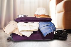Travel bag with clothes. Stock Images