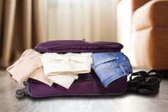 Travel bag with clothes. Royalty Free Stock Photography