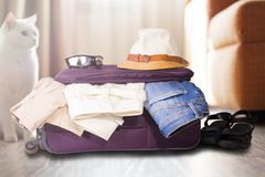 Travel bag with clothes. Stock Photography