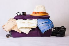 Travel bag with clothes. Stock Photos