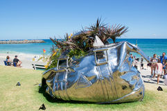 Travel Bag. COTTESLOE,WA,AUSTRALIA-MARCH 12,2016: Metal travel bag sculpture with plants at the interactive arts festival with families at Cottesloe Beach and stock images