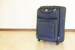 Travel bag on a floor. Royalty Free Stock Image