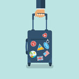 Travel bag in hand. Carrying suitcase. Stock Photography