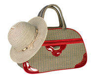 Travel bag and hat on a white background Stock Images