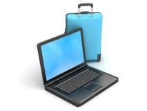Travel bag and laptop Stock Photos