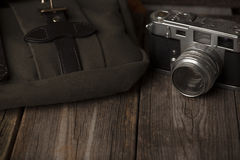Travel bag and retro camera. Royalty Free Stock Images