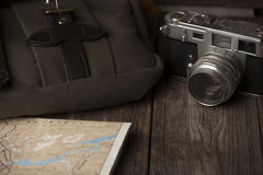 Travel bag and retro camera, with map Royalty Free Stock Images