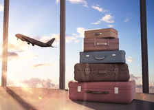 Travel bags. And airplane in sky Stock Images