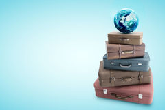 Travel bags and earth vector illustration