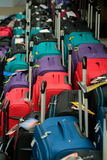 Travel bags on shop display. Travel bags, modern wheeled suitcases, with handles for luggage on shop display for sale as colorful background Royalty Free Stock Photo