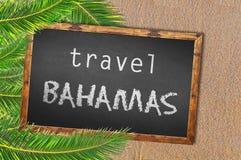 Travel Bahamas palm trees and blackboard on sandy beach. Close royalty free stock photography