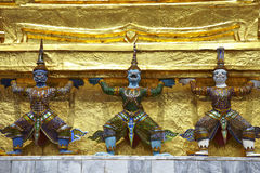 Travel in bangkok. Three gian stand on gold background Stock Images