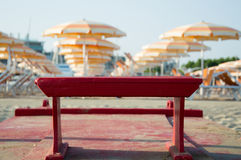 Travel beach Romagna - beach and sea in Rimini with red rescue b. Oat and orange umbrellas Royalty Free Stock Photos