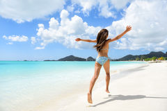 Travel beach vacation holidays bikini girl happy Stock Photography