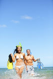 Travel beach vacation people - happy couple fun Stock Images