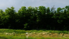 Travel through the beautiful countryside of Hungary. View from the window of a moving car stock video