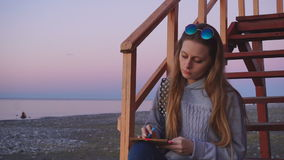 Travel: beautiful girl tourist drawing sunset at stock footage