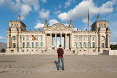 Travel in Berlin, tourist man looking at Bundestag building in Berlin, Germany stock photo