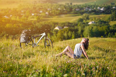 Travel with bicycle alone - young woman tourist Stock Photography
