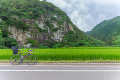 Travel by the bicycle on the Sado island. Niigata, Japan - August 12, 2014: Travel by the bicycle on the Sado island. Sado Island lies off the coast of Niigata royalty free stock photos